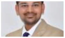 Dr. Mahesh G